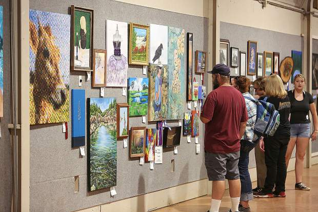 Fair goers take in the art of Nevada County entrants in the Northern Mines buildings.