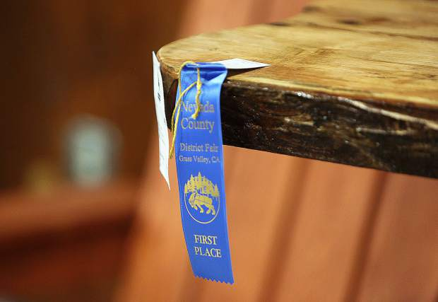 A first place ribbon is placed on a piece of woodwork.