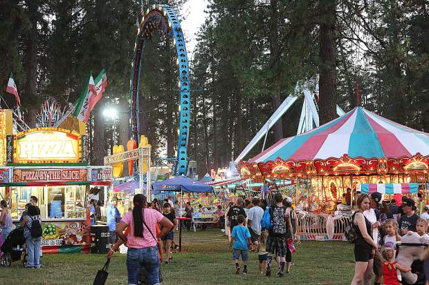 The midway of fun is lit up as the sun goes down Wednesday evening of the 2019 Nevada County Fair.