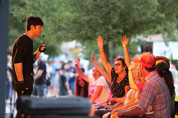 Michael Mezmer: America's Award Winning Comedic Hypnotist works with a group of hypnotized fair goers Wednesday evening from the Pine Tree Stage.