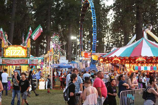 The midway of fun is lit up with an abundance of carnival rides and games during the five day Nevada County Fair.