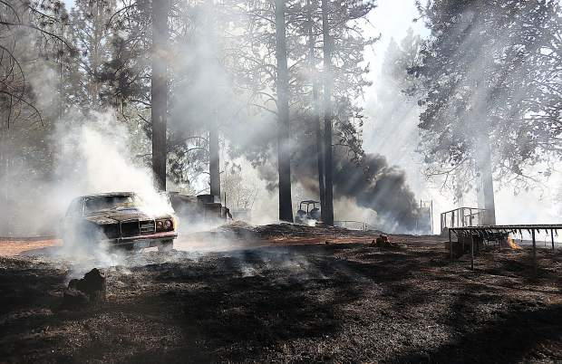A vintage Mercedes, a container shed, and an RV all succumbed to Thursday's 5 acre blaze.