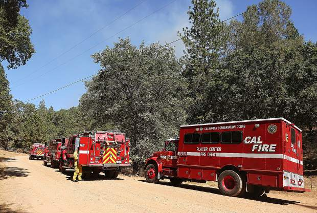 Firefighters from Nevada County and Placer County responded to Thursday's vegetation fire off of Dog Bar Road at Venus Court.