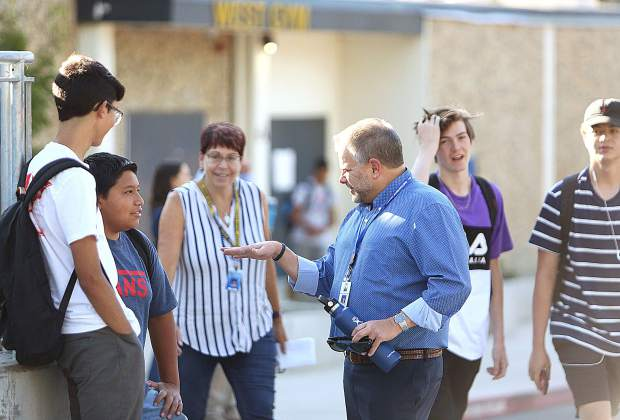 Nevada Joint Union High School District Superintendent Brett McFadden mingles with students in front of Nevada Union High School before the first day of school Wednesday morning.