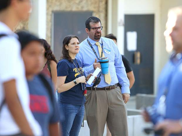 Nevada Union High School administrators keep an eye on the inflow of students Wednesday morning from the front of the school.