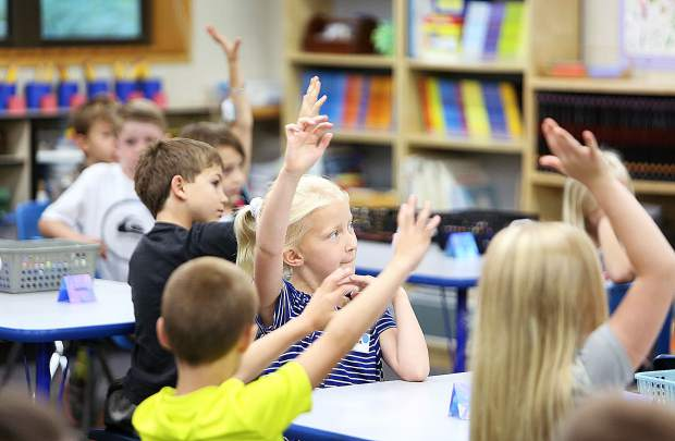 Students in Tracy Green's second grade class raise their hands to answer a question during the first day of school of the 2019-2020 school year at Deer Creek Elementary Wednesday. Classes began Wednesday morning for students across Nevada County.
