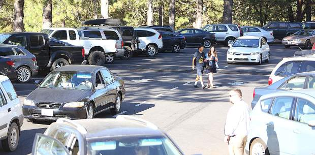 Students, parents and school administrators navigate the Nevada Union High School parking lot before school Wednesday morning.
