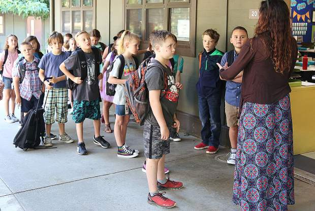 Students from Mrs. Machado's 3rd grade class are taught proper etiquette for entering the classroom Wednesday morning.