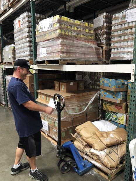 Bob Dion, operations director at the Food Bank of Nevada County, moves a pallet at the nonprofit's Railroad Avenue warehouse in Grass Valley.