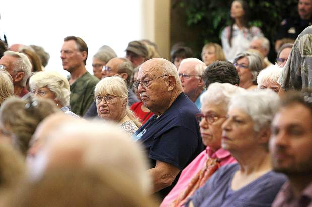 Faces in the crowd react to the information given by Insurance Commissioner Ricardo Lara during his presentation Thursday at the Foothills Event Center in Grass Valley.