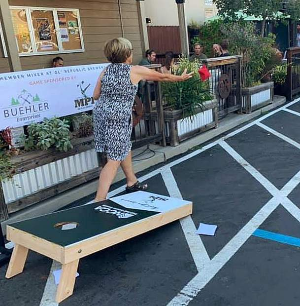 A cornhole tournament was among the many festive activities at the Nevada County Contractors' Association business mixer, as demonstrated by NCCA Executive Director Barbara Bashall and her deadly-accurate throwing arm.