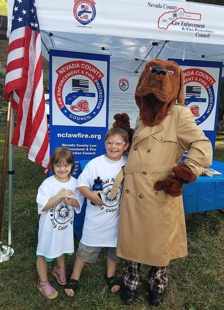 McGruff the Crime Dog not only enjoys taking a bite out of crime, he also loves immortalizing in photographs bunny ears on young fans. Five-year-old Luna Friedman and six-year-old Cash Friedman are McGruff's crime-fighting friends.