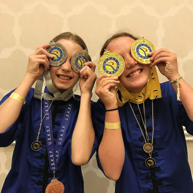 Amelia Regan, left, and Kayla Aaron combined to win two golds, two silvers and a bronze medal at the U.S. International Kuo Shu Championship Tournament held in Hunt Valley, Maryland in late July.