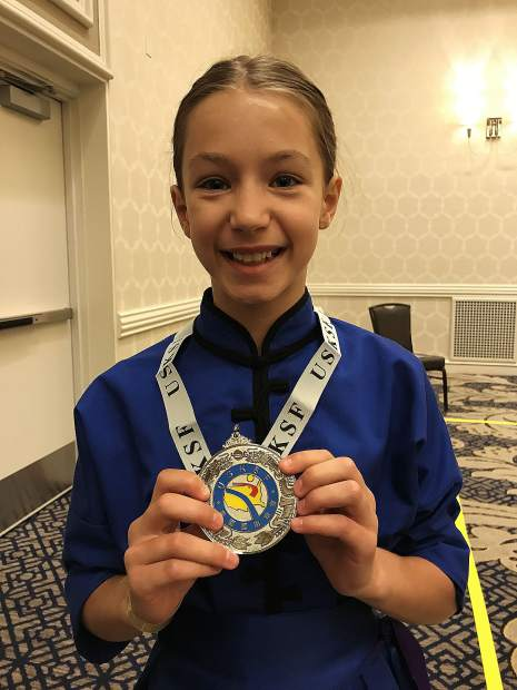 Amelia Regan earned two silvers and a bronze medal at the U.S. International Kuo Shu Championship Tournament held in Hunt Valley, Maryland in late July.