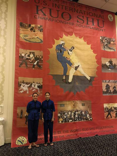 Amelia Regan, right, and Kayla Aaron combined to win two golds, two silvers and a bronze medal at the U.S. International Kuo Shu Championship Tournament held in Hunt Valley, Maryland in late July.