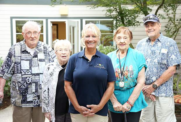 Sam Eustice, from left, Barbara Eustice, Colleen Trotter, Lorraine Nienaber, and Joe Lipscomb stand on the back patio of Cascades Assisted Care center off of Sierra College Drive. Colleen owns Sunnyside Senior Transition Services with her husband Steve Trotter.