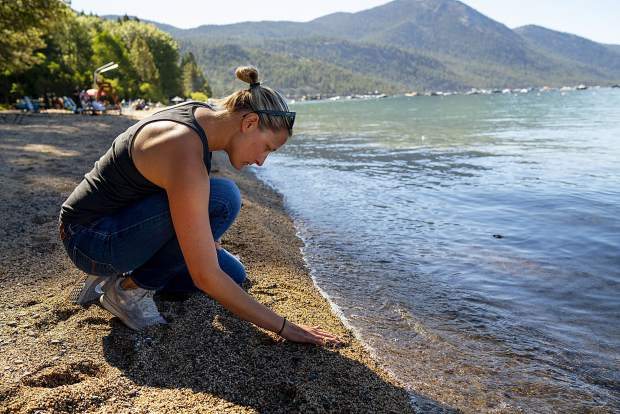 UC Davis staff Research Associate, Katie Senft, checks the sand for plastic at Incline Beach, Lake Tahoe. Senft is studying how much micro plastic finds its way into Lake Tahoe and beaches surrounding the lake.