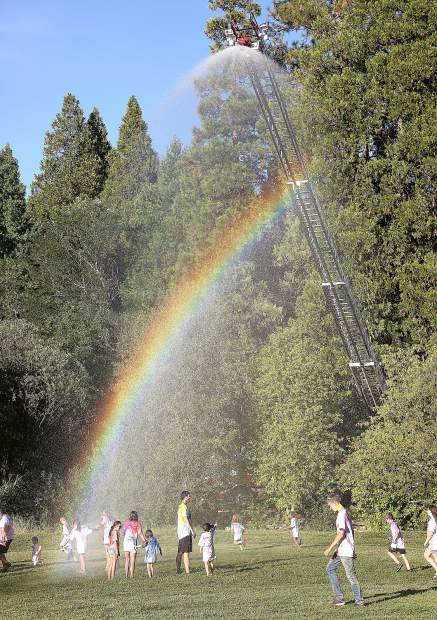 Grass Valley Fire Engine No. 2 sprayed water from the top of the ladder much to the delight of the color run participants.