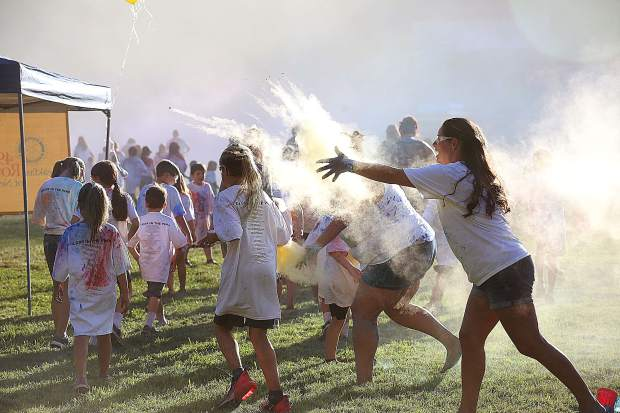 Volunteers make sure that no one goes without color during the annual National Night Out color run held this year at Nevada CIty's Pioneer Park.