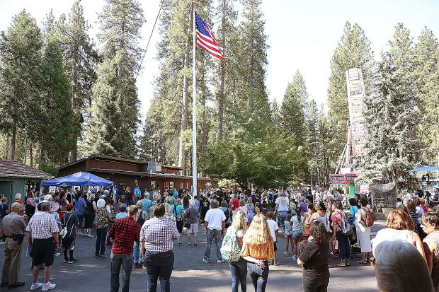 The U.S. flag is raised during the opening ceremonies of the 2019 Nevada County Fair.