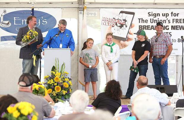 The Hansen family was honored as the fair family of the year during the opening ceremony Wednesday at the special events stage.