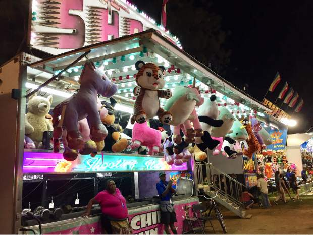 Carousels and games are always a hit at the Fair.