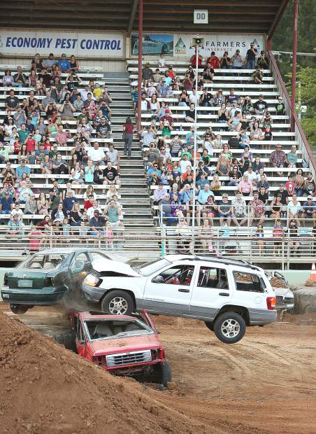 The Kamikaze Kid goes airborne as he crashes his Jeep Grand Cherokee into a wall of vehicles to the delight of spectators during Thursday evening's Motocross Madness thrill show.
