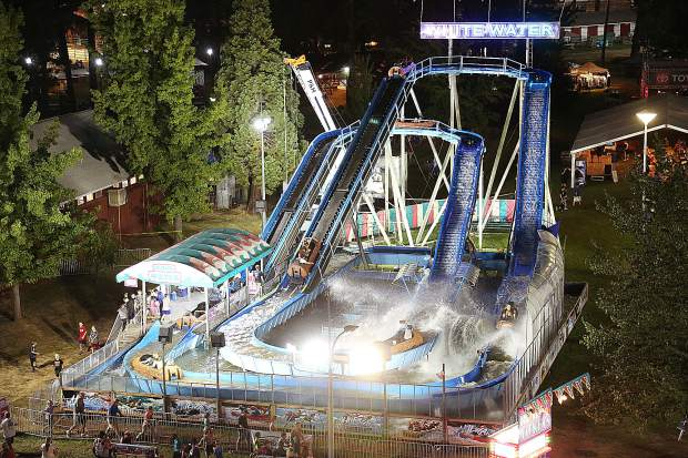 Screams and cheers of delight emanate from the White Water log ride well into the evening as folks ride the new and popular addition to the 2019 Nevada County Fair.