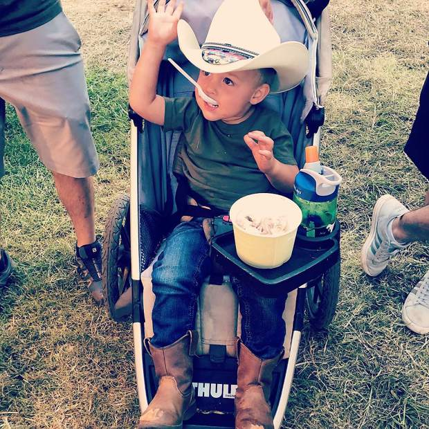 My grandson Sebastian at this year's fair, enjoying a treat!