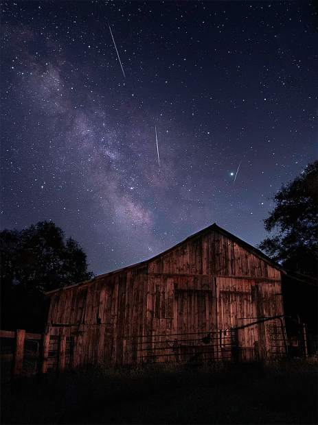 The Perseids meteor shower over an old Grass Valley barn.