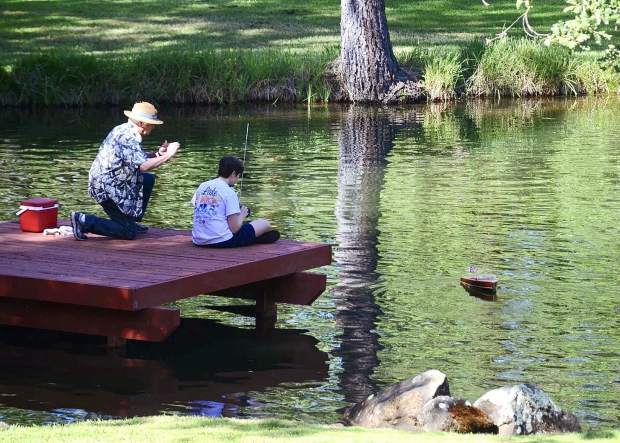 Grandpa and grandson spending a quiet morning together at a friend's beautiful pond.