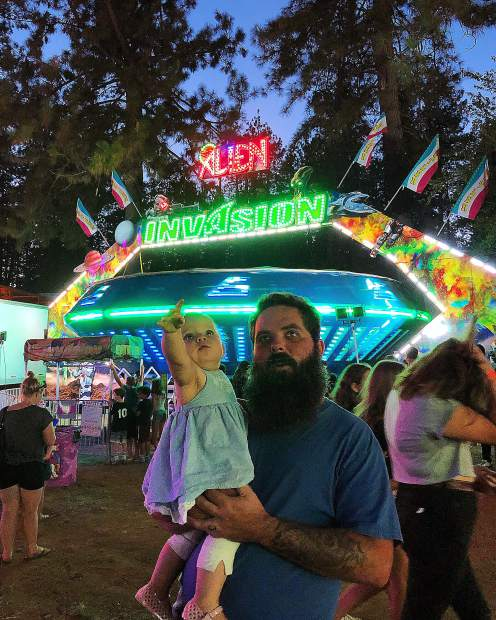 This year was our first time at the Nevada County Fair. Pictured on the right is my husband Erik Stoner holding our one year old daughter Harper Stoner on the left. She was mesmerized by all the bright lights!