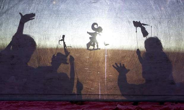 The Digital Dalang Indonesian Shadow Puppet Theater installation featured traditional cut out shadow puppet characters as well as digitally created ones created by the shape of your hand.
