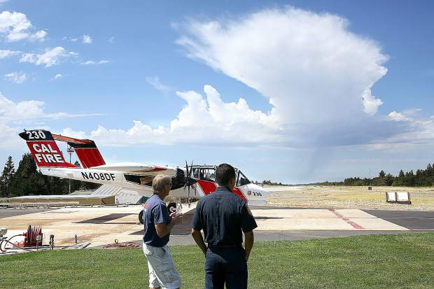 Grass Valley Air Attack Base firefighters keep an eye on thunderclouds that could pose the potential for dry lightning strikes, the main factor in the declaration of Wednesday's red flag warning. The last red flag warning was issued in mid-July.