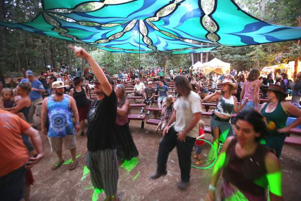 Folks dance to The Human Revolution during Saturday evening's lineup at Ridgestock at the North Columbia Schoolhouse.