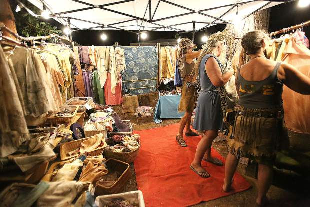 Folks search for new threads at one of the sustainably sourced clothing booths made available during Ridgestock.