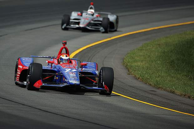 Alexander Rossi (27) leads Will Power (12) through Turn 3 during a practice session for Sunday's IndyCar Series auto race at Pocono Raceway, Saturday, Aug. 17, 2019, in Long Pond, Pa. On Sunday, Alexander Rossi was involved in a collision on lap one of the race, but returned later to finish 18th.