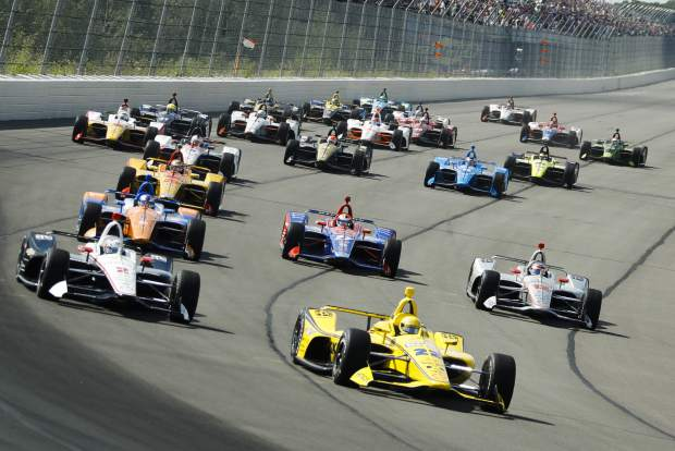 Drivers enter Turn 1 after taking the green flag to start the IndyCar Series auto race at Pocono Raceway, Sunday, in Long Pond, Pa. Alexander Rossi, second row middle, was involved in a collision on lap one, but returned later to finish 18th.