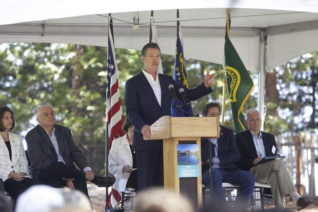 Gov. Gavin Newsom addresses the crowd during the Lake Tahoe Summit on Tuesday.