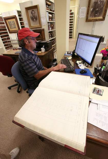 Library volunteer Steve Fry works to catalog information from Nevada City's assessment tax books and will likely help to catalog Grass Valley's logs.