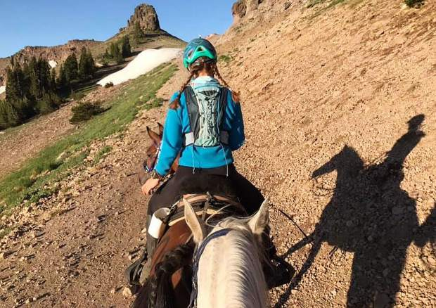 On the trail with ride buddy Amrita O'Leary on Maya.