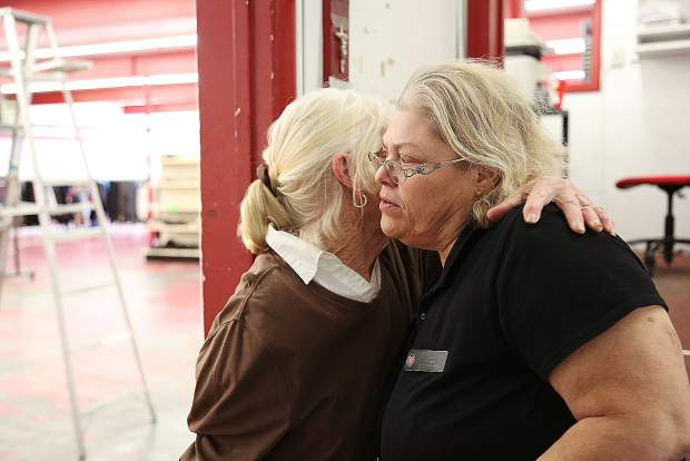 Salvation Army Thrift Store manager Cindy Alejandriz gets a hug from long time shopper Sandie DeCordova Thursday at the downtown Grass Valley location. Today will be the final day that the store will be open and items are being sold at discounted prices.