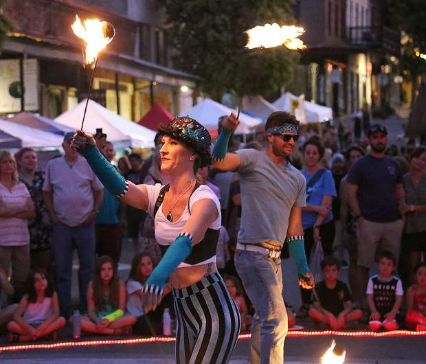 The Sol Risers fire dancers based out of Nevada County captivated the attention of many in downtown Grass Valley to close out the final Thursday Night Market of the summer season.