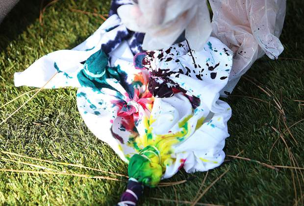 A youngster's tie dye creation comes to life with an array of vibrant colors.