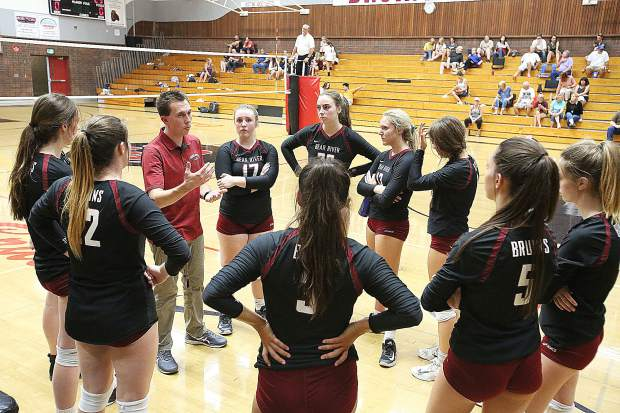 Bear River varsity girls volleyball head coach Matt MacDonald talks to his team in between sets during the Bruins' win over Casa Roble.