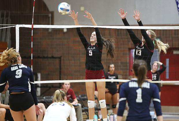 Bear River junior Kerynn Smith (5) and Summer Huntley (13) look to block a Casa Roble spike during Thursday's win for the Bruins.
