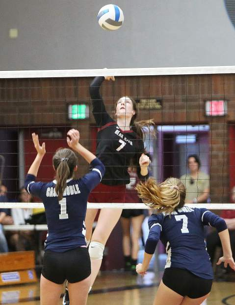 Bear River junior Sydney Franks prepares to spike the ball over the net during Thursday's match against Casa Roble.