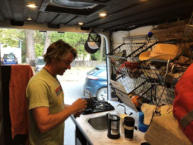 Sean Ross is making tea in his van. The freelance audio engineer feels that he doesn't need the comforts of a stable home.