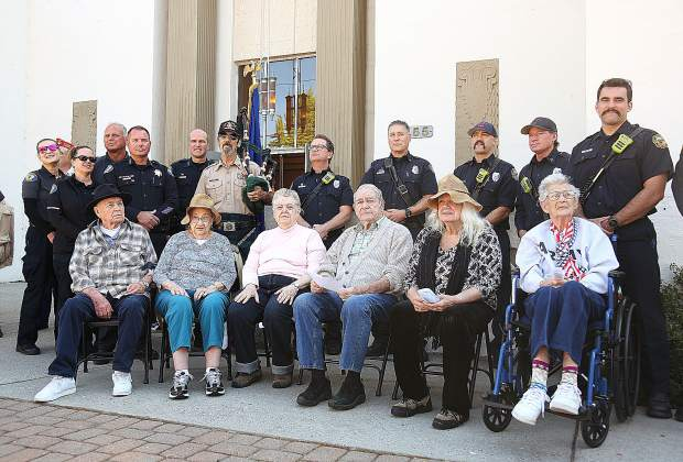 Area first responders along with WWII, Korean, and Vietnam war veterans (from left) David Knobloch, Mary Anne Morgese, Claire Gilmore, Vincent Paloma, Pam Adamson, and Bernie Bachli, were all honored as part of Wednesday's 9/11 commemoration ceremony in front of the Grass Valley Veterans Memorial Building.