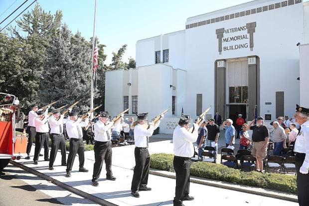 American Legion Frank Gallino Post 130 honor guard members take part in a 21 gun volley to honor the victims of the 9/11 attacks during Wednesdays ceremony in front of the Grass Valley Veterans Memorial Building.